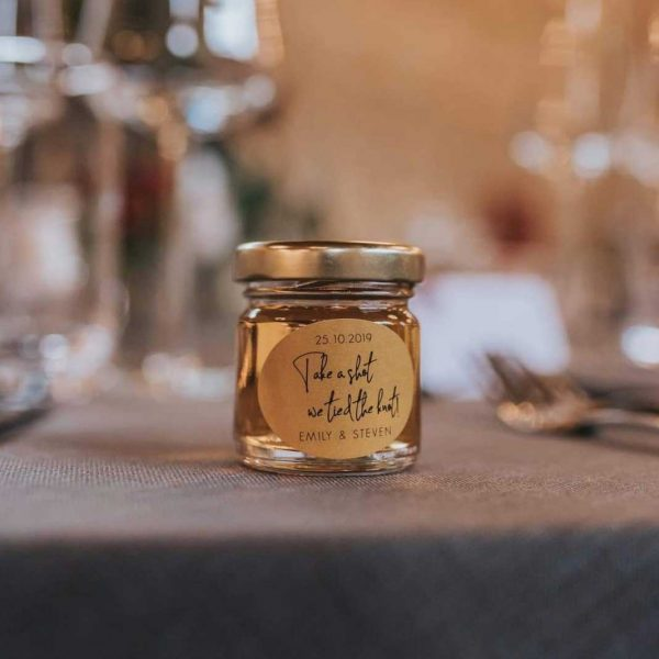 Cute Mini jar with gold lid filled with a shot for Wedding Favour
