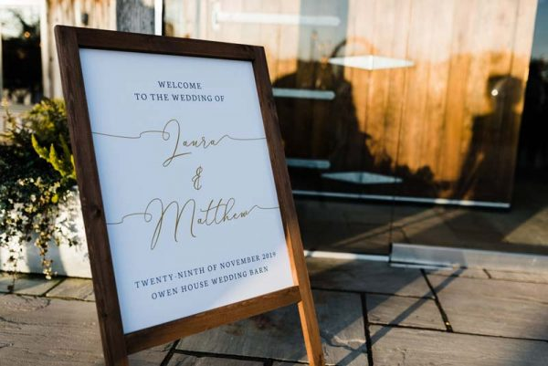 Wooden Welcome Sign at Wedding Entrance with Calligraphy text