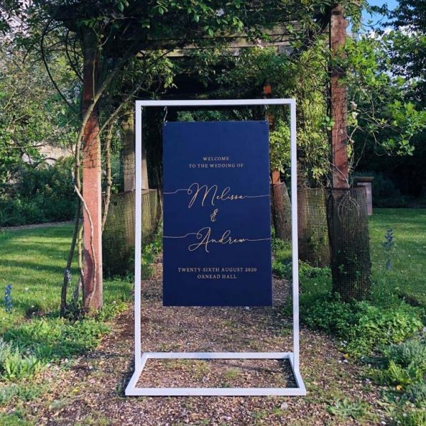 White Metal Frame with Navy Calligraphy Welcome Sign hanging